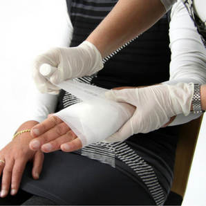 first aid at work, course, training, bandaging arm, casualty, injury